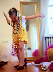 Young girl playing dress-up