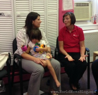 Jennifer Burden of World Moms Blog and her 2-year old daughter sit down with Kathy in St. Anne's child care in Keansburg, NJ 10 months after Hurricane Sandy affected the area.