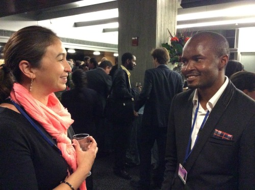 World Mom and RESULTS Board Member, Cindy Levin, talks with graduate student and change maker Patrick from Congo at the reception following the World Bank and IMF Civil Society Town Hall. October 8th, 2014.