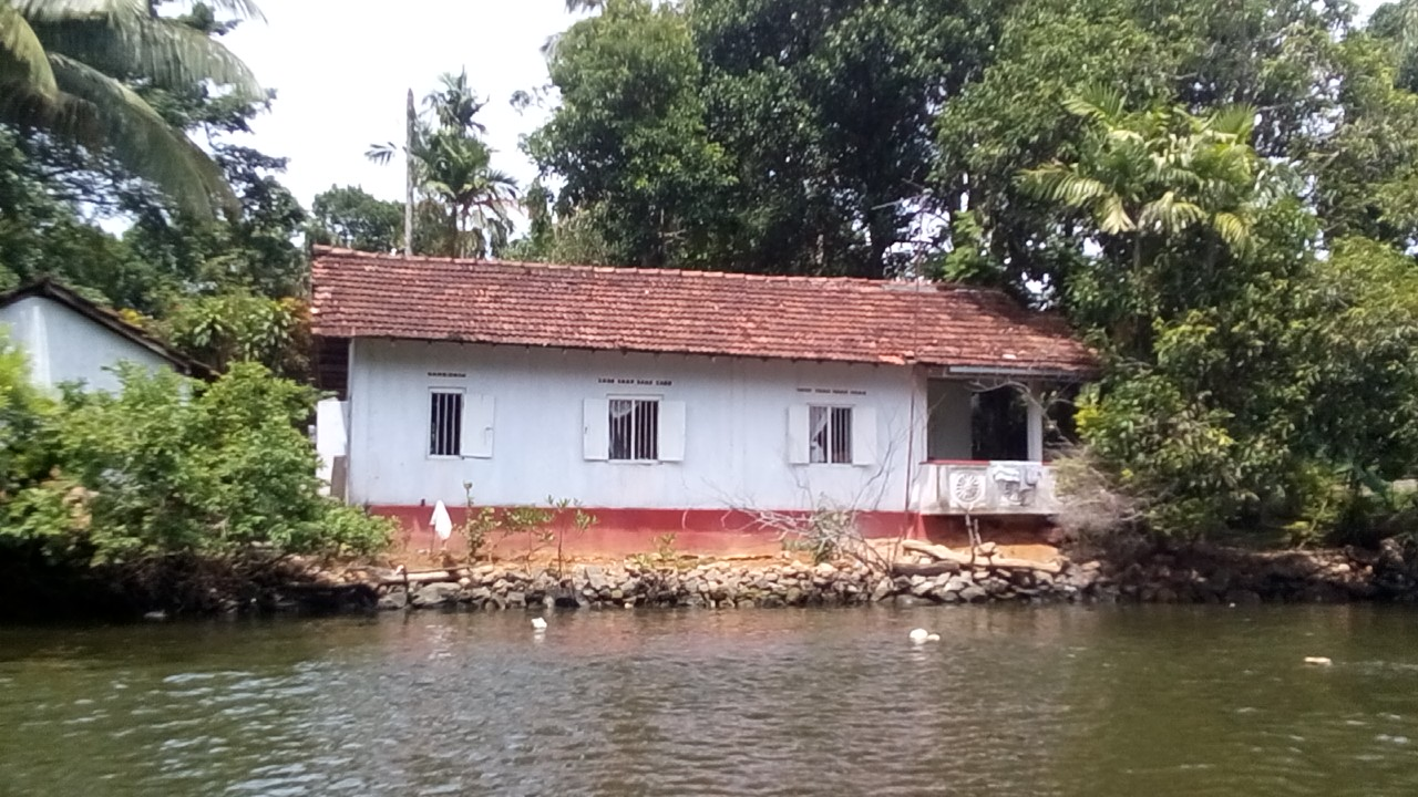 A beautiful traditional river house on the banks of Madu River