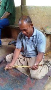 Mr. Lalit Galle shaving his cinnamon stick