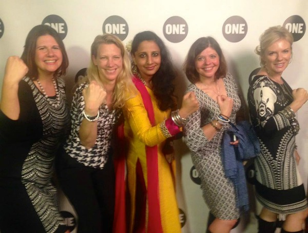 """World Moms pose for a """"Strengthie"""" with Neha Misra of Solar Sisters at a ONE Event in NYC in September, 2015."""