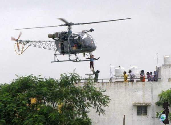 A helicopter evacuates a woman who needs medical care in Chennai, India.