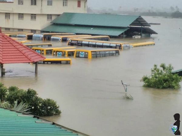 The school of the photographer's daughter and buses under water in Chennai due to extreme flooding.