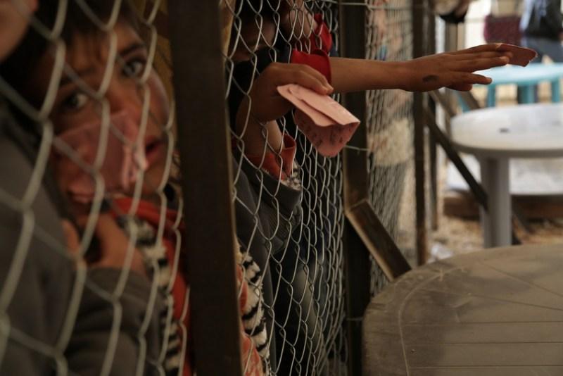 Save the Children distributes bread to residents of Za'atari refugee camp. Photo credit: Nicole Itano/Save the Children