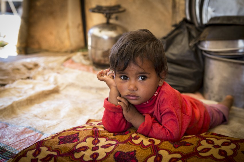 Zeina *, two, at her home in a tented refugee settlement in Lebanon, near the Syrian border. *Names have been changed to protect identities. Photo credit: Jonathan Hyams/Save the Children