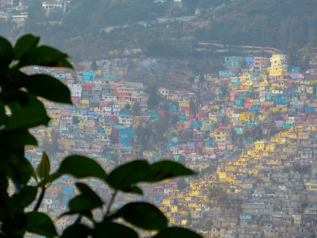 """The """"gingerbread"""" homes that rise up in the slums above Port au Prince, Haiti."""
