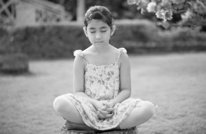 A child practicing Heartfulness Relaxation